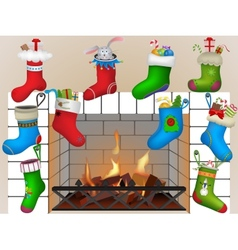 Christmas socks by the fireplace vector