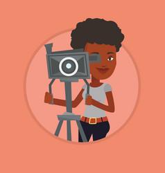 cameraman with movie camera on tripod vector image
