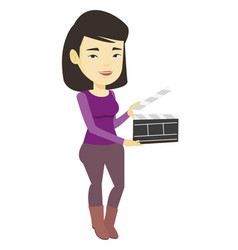 Smiling woman holding an open clapperboard vector