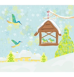 Birdfeeder in winter vector