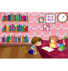 A girl and a boy reading inside a room vector image