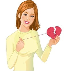 Young beautiful girl repairs fabric heart vector