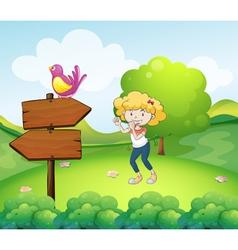 A woman dancing near an arrow board with a bird vector image vector image