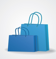Realistic blue shopping bags with rope handles on vector