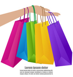 Woman hand holding colorful shopping bag vector