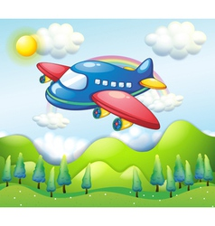 A colorful airplane above the hills vector