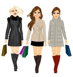 Three young fashion women in autumn clothes vector