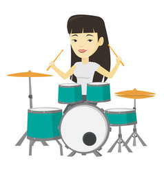 Woman playing on drum kit vector