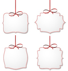 White paper gift cards with red satin bows vector