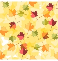 Seamless autumnal background with leaves of maple vector