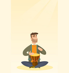 Man playing the ethnic drum vector