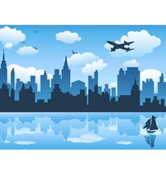 city in blue sky and its reflection on water vector image