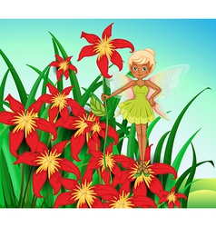 A fairy standing above a red flower vector
