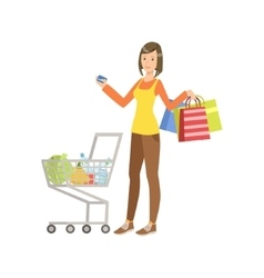 Woman with shopping bags and full cart holding vector