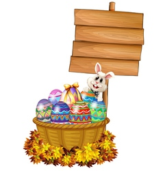 A bunny and a basket with eggs near a signage vector image vector image
