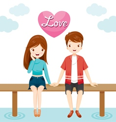 Man and woman sitting together on bridge vector