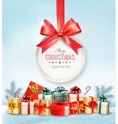 Christmas presents with a gift card and a ribbon vector