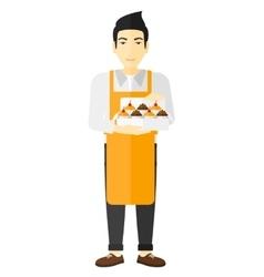 Baker holding box of cakes vector