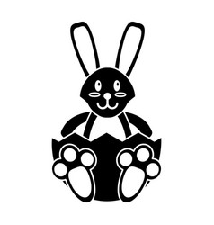 Easter bunny with broken egg pictogram vector