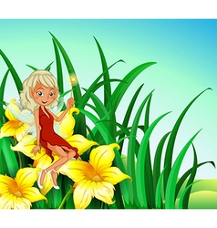 A fairy holding a wand sitting above a flower vector