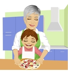 Grandmother with her grandson preparing pizza vector image