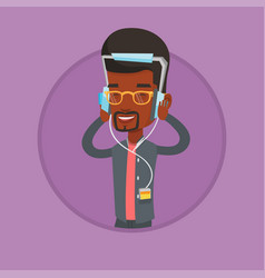 young man in headphones listening to music vector image