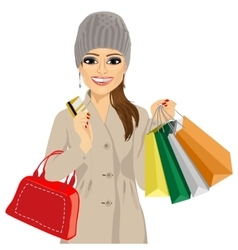 Woman in a winter coat and knitted hat vector