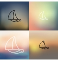 Sailboat icon on blurred background vector