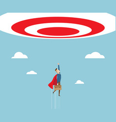 Businessman in red cape flying to target vector