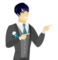Young asian groom pointing to the side vector