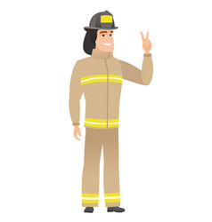 Caucasian firefighter showing the victory gesture vector