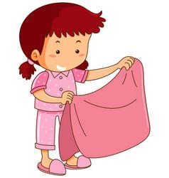 Girl in pink pajamas holding pink blanket vector