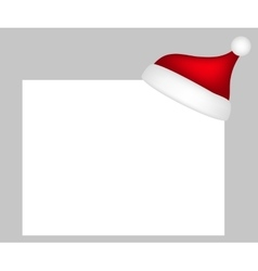 Hat of santa claus with a blank white banner vector
