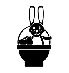 Easter rabbit inside egg basket pictogram vector