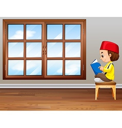 Muslim boy reading a book vector