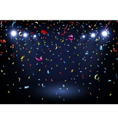 colorful confetti on black background with spotlig vector image