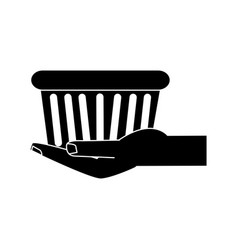 hand holding shopping basket icon image vector image