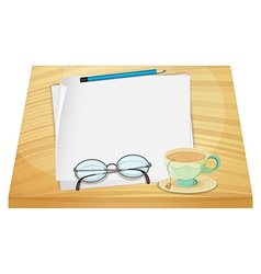 A wooden table with an empty paper and a cup of vector image