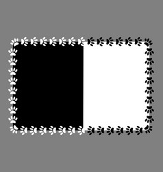 frame paw prints on black and white background vector image vector image