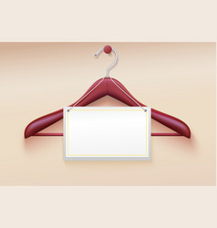 wooden hanger with tag isolated on cream vector image vector image