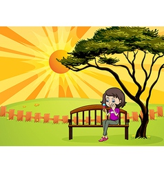 A girl in the park sitting in the wooden bench vector image vector image