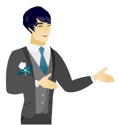 Young asian happy groom gesturing vector