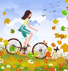 Beautiful girl is riding on a bicycle in a autumn vector image vector image