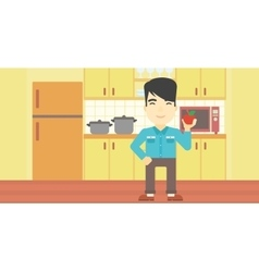 Young man with apple in the kitchen vector
