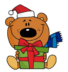 christmas bear holding a present vector image vector image