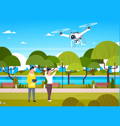 Young people playing with drone copter in park man vector