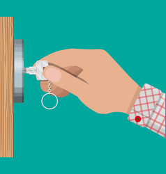 key in hand opens wooden door vector image