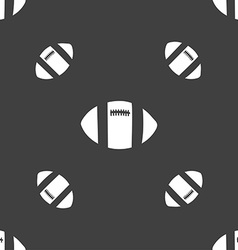 Rugby ball icon sign seamless pattern on a gray vector