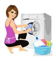 Young housewife putting cloth into washing machine vector