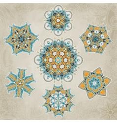 Ornate snowflakes set vector image